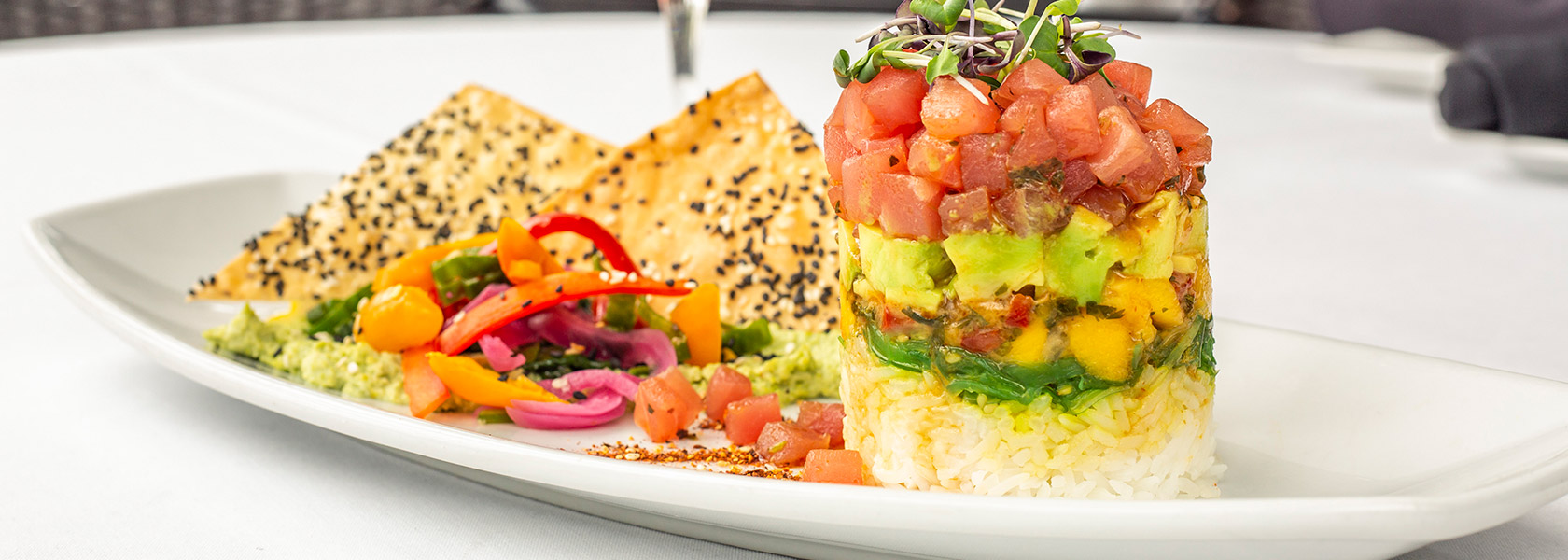Tucci's Tuna stack entree with avocado and seeded chips