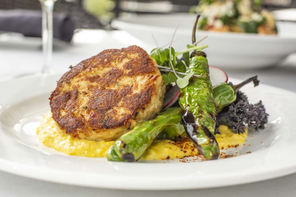 Tucci's crab cakes plated on polenta with asparagus