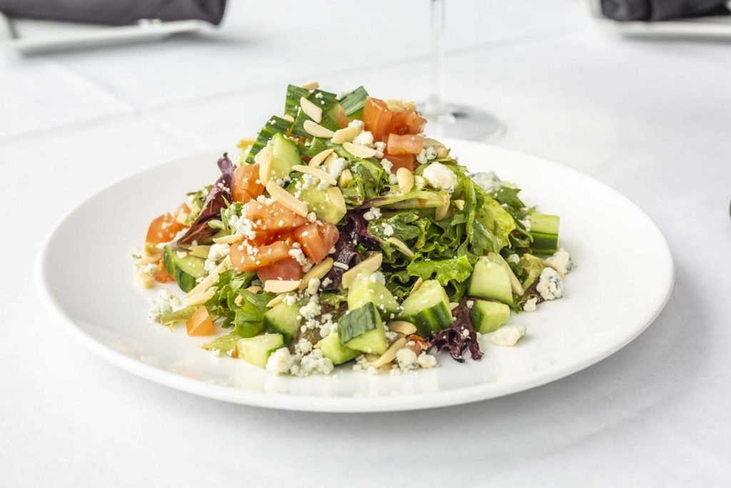 Tucci's salad with chopped greens and tomatoes