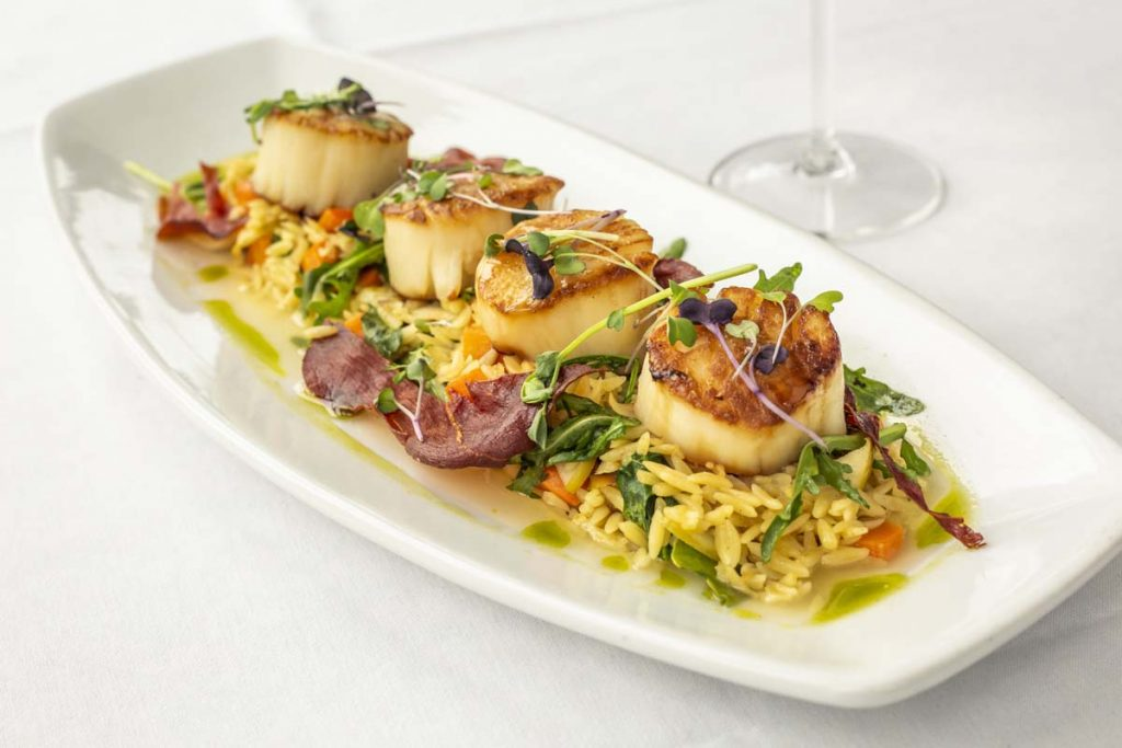 Tucci's jumbo pan-seared scallops on bed of orzo pasta